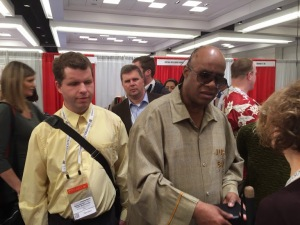 Tom Babinski and Stevie Wonder meet on day 5 in CSUN Exhibition Hall.