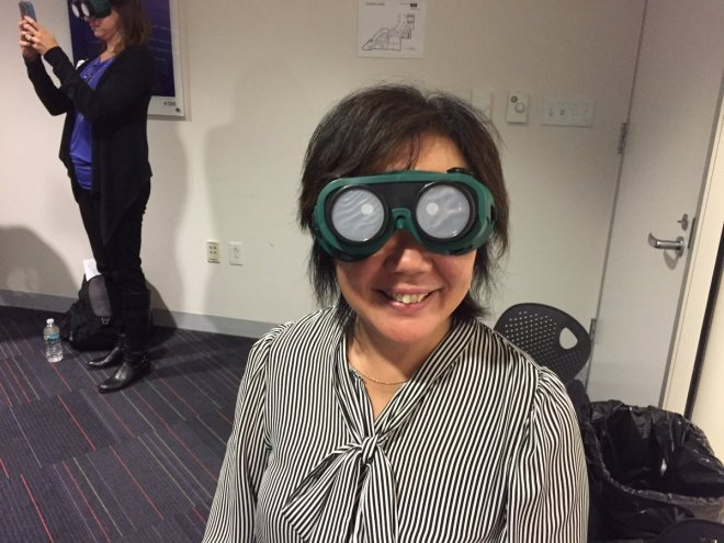 Frances West tries on a pair of low vision simulator goggles during an empathy building exercise. (Photo courtesy of Marcus Yee)